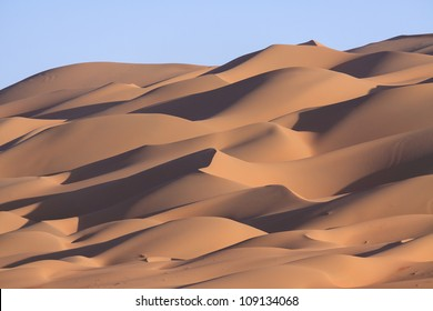 Lines of sand dunes on a hill near Liwa Oasis in the United Arab Emirates