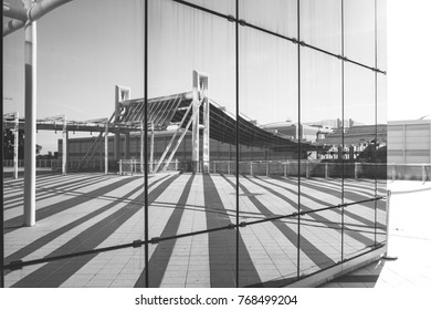 Lines and shapes reflected in glass wall, architecture photography in black and white.
