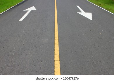 lines and signs on local asphalt road