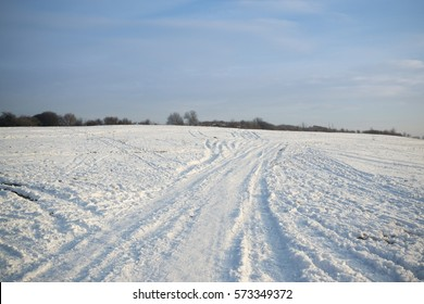 Lines in snow on meadow during winter. Slovakia