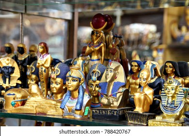 Lines of trinkets and curios line a shelf in a shop for tourists in Cairo, Egypt.
