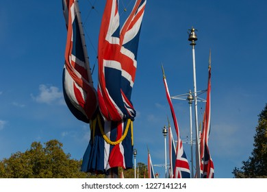 Lines of union jack flags hanging along the Mall, London