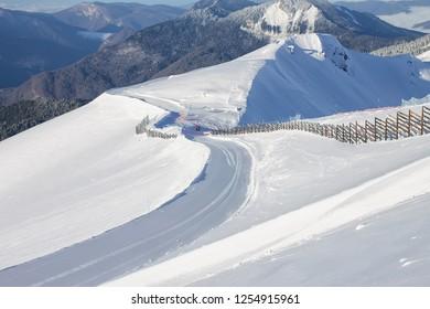 Lines of velveteen fresh ski slopes on Mount Rosa Khutor in Krasnaya Polyana