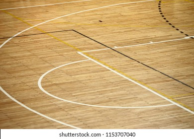 Lines of wooden floor basketball court in the sports hall.
