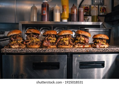 Lineup of cheese and bacon burgers