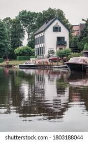 Linge river, Netherlands – June 5, 2018:  Beautiful white vila along the bank of the river Linge in the Netherlands