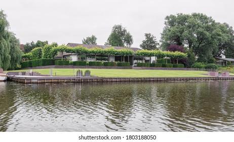 Linge river, Netherlands – June 5, 2018:  Beautiful vila along the bank of the river Linge in the Netherlands