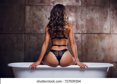 lingerie beautiful girl in underwear sits on a bath