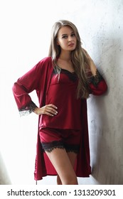 Lingerie and nightwear. Beautiful girl in red nightgown