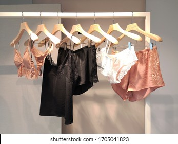 Lingerie on sale. Few women's underwear and nightclothes on rack in retail store. Poor assortment in display window of fashion clothing shop in concept of vulnerable small business trying to survive.