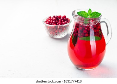 Lingonberry and lime punch or limeade in a glass jar, horizontal, copy space