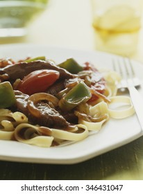 Linguine with beef and peppers.Italian food.