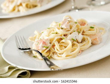 Linguine with creamy salmon, crab and shrimp sauce.
