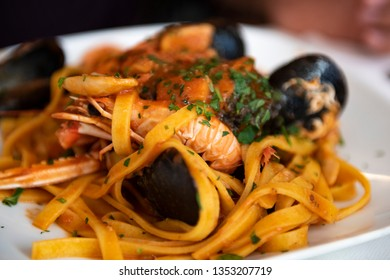 linguine with tomato sauce with scampi and mussels