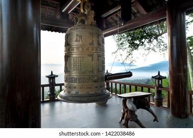 """Linh Quy Phap An"" temple, Bao Loc town, Lam Dong Province, Vietnam - Jun 2, 2019: the bell tower at ""Linh Qui Phap An"" temple, near Bao Loc town, Lam Dong province, Vietnam"