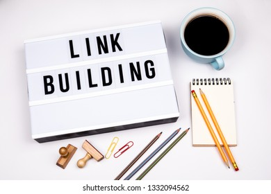 Link Building. Text in lightbox. White desk with stationery