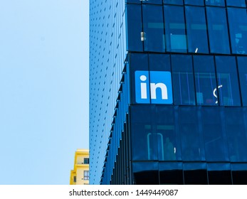LinkedIn sign and logo on glass facade of professional networking company office in Silicon Valley. LinkedIn is subsidiary of Microsoft - San Francisco, California, USA - July 12, 2019