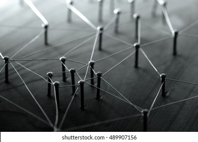 Linking entities. Network, networking, social media, internet communication abstract. Web of wires on wood. Monotone or Black and White.