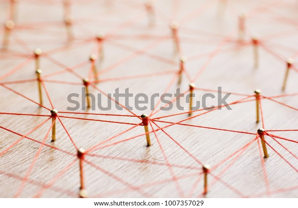 Linking entities. Network, networking, social media, internet communication abstract. Web of wires on wooden.