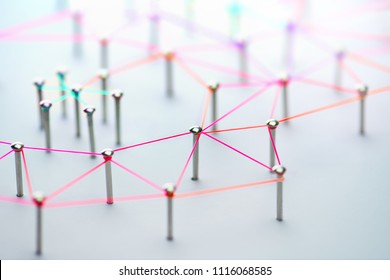 Linking entities. Networking, social media, SNS, internet communication abstract. devices or people connected to a network. Colorful Web of red, pink, orangeand green wires on white