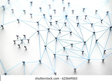 Linking entities. Networking, social media, SNS, internet communication abstract. Small network connected to a larger network. Web of light blue, wires on white background.