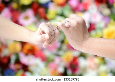 Linking little fingers with somebody to confirm promise