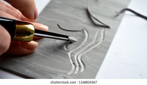 Linocut artist hand curving printmaking hobby
