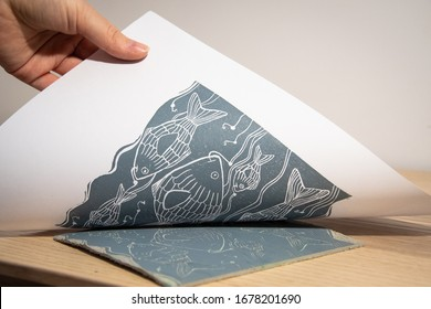 The linocut artwork is transferred on a white paper, dark grey ink is used for this art piece