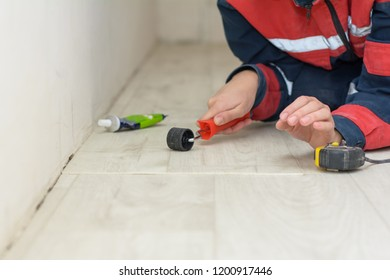 Linoleum appliances, cutting and samples. flooring installation. Worker measured and marked on the linoleum. Worker cutting linoleum. tape-measure