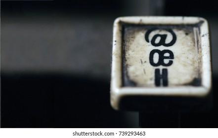 Linotype keyboard letters oe, h keys closeup at newspaper shop. Provost, Alberta, Canada.