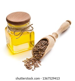 Linseed oil in bottle and scoop with linseeds isolated on white background. Healthy fats concept