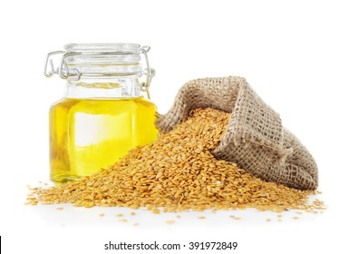 Linseed oil and golden flax seeds close up isolated on white background