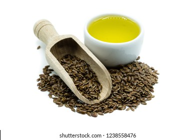 Linseed and linseed oil isolated on white background