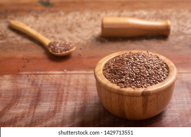 Linseed in a wooden bowl over a table