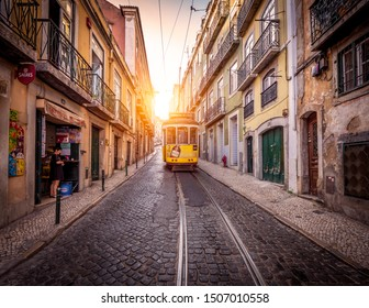 LINSON, PORTUGAL - SEPTEMBER 10, 2019: The historic architecture of Lisbon in Portugal with its cobblestone streets, ancient buildings, and famous trolleys travelling through the Alfama neighborhood.