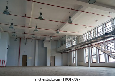 lInterior of a large empty room with mezzanine
