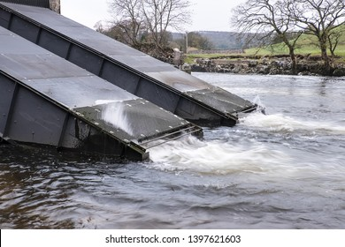 Linton, Wharfedale, Yorkshire Dales National Park, North Yorkshire, England, Britain, November 2015, screw pumps (Archimedes Screws) operating in River Wharfe