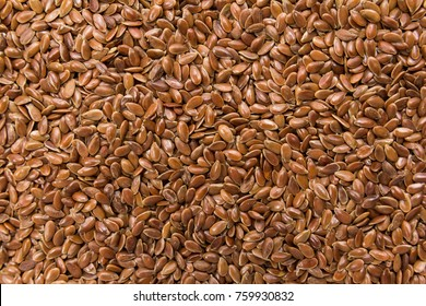 Linum usitatissimum is scientific name of Brown Flax seed. Also known as Linseed, Flaxseed and Common Flax. Closeup of grains, background use.