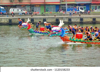 LINYUAN, TAIWAN -- MAY 28, 2017: Two unidentified teams compete in the Dragon Boat Races at Zhongyun Fishing Port in Taiwan.