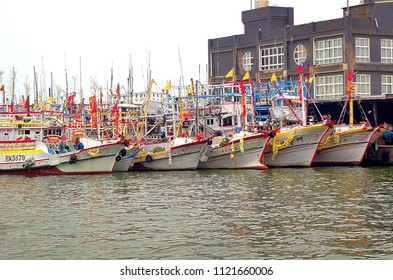 LINYUAN, TAIWAN -- MAY 28, 2017: A fleet of fishing boats is anchored at the port of Zongyungang in southern Taiwan.