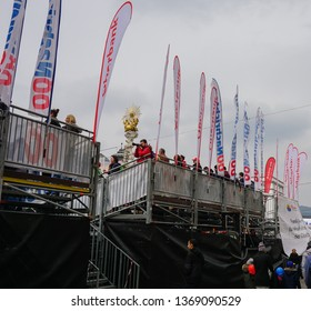 "LINZ, AUSTRIA - APRIL 14, 2019: The Linz Donau Marathon. Spectators are looking at the marathon at main square ""Hauptplatz"" of Linz."
