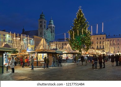 LINZ, AUSTRIA - DECEMBER 9, 2017: The city's main Christmas market at the baroque Hauptplatz (Main Square) in dusk. It is known as a market of handicrafts, artisans and artists.