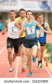 LINZ, AUSTRIA - JANUARY 30, 2014: Artur Ostrowski (#3 Poland) places 4th in the men's 1500m event in an indoor track and field meeting.
