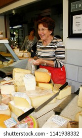 LINZ, AUSTRIA – JUNE 21, 2008: unidentified woman sell cheese in the Sudbahnhofmarkt on June 21, 2008 in Linz, Austria