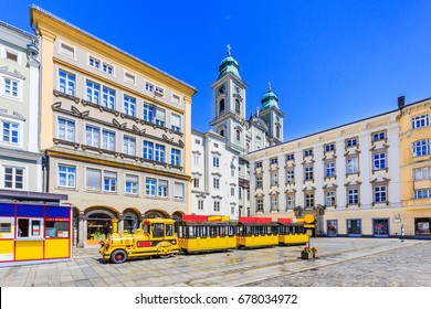 Linz, Austria. Old Cathedral (Alter Dom) and tourist train in the Main Square (Hauptplatz)