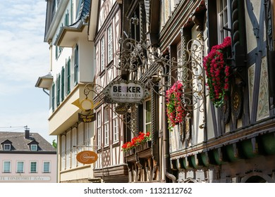 Linz am Rhein, Germany May 31, 2018: half-timbered houses in the old town of Linz am Rhein with antique signs. The town is a popular tourist destination because of its colorful half-timbered houses