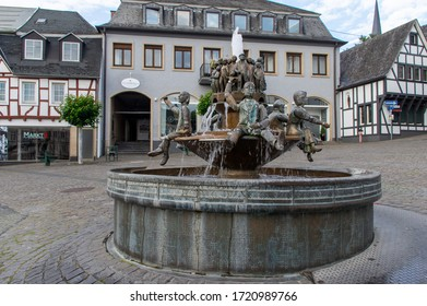 Linz am Rhein, Rhineland-Palatinate/Germany - June 5th 2019: council fountain in front of the town hall. The people stand by the heads of the people who govern and take care that they don't mess up.