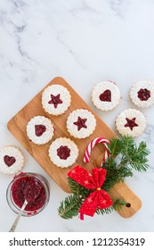 Linzer Christmas cookies with jam and powder sugar flat lay and copy space. Creative concept.