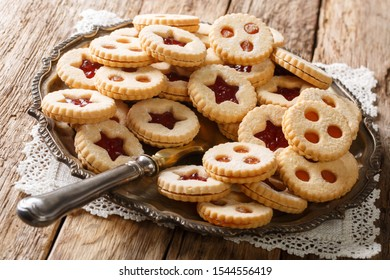 Linzer cookies with jam on a plate on the table. Traditional Austrian biscuits filled. horizontal