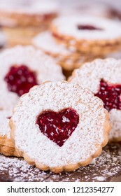 Linzer cookies with raspberry jam close up view.